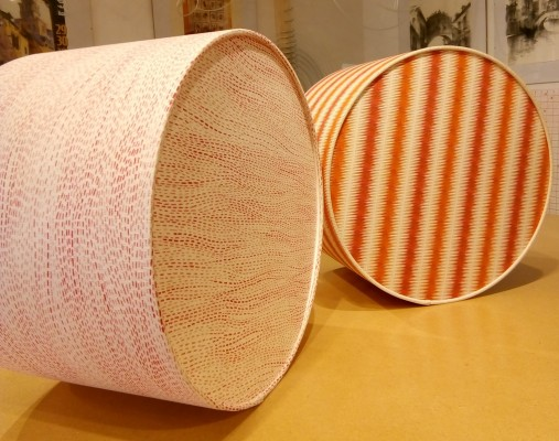 Rigid lampshades with fabric covered diffusers